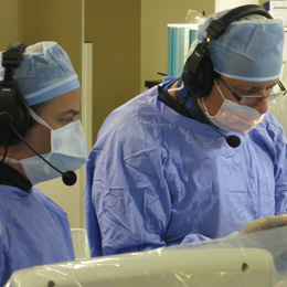 Picture of doctors wearing face mask and a headset