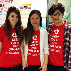 Image of three people wearing AYA shirts