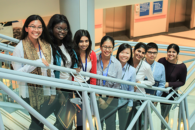 Group of Summer Student Clinician Scientist program graduates from 2017 cohort standing on staircase at Princess Margaret