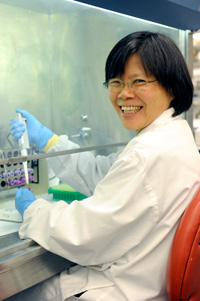 Image of lab technician smiling