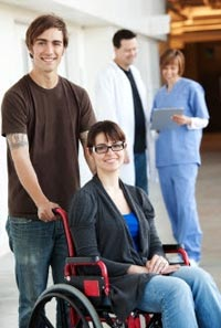 Patient in wheelchair and caregivers