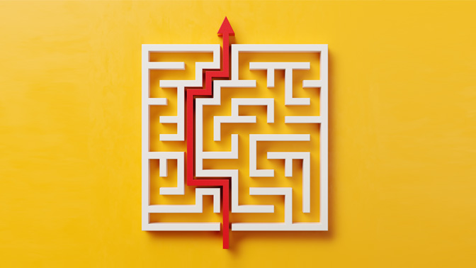 maze with red arrow through it