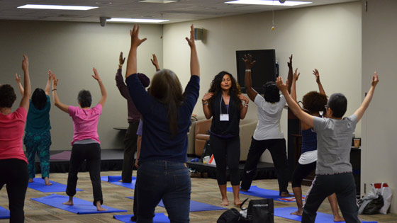 Image of participants learn how to do Yoga