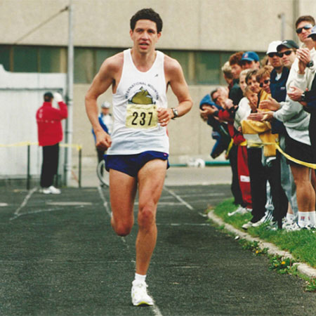 Mark Bayley running down a track