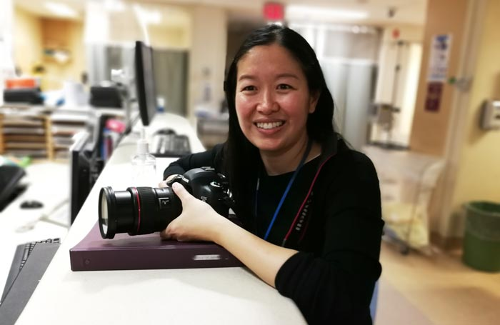 Dr. Lim with camera in ER
