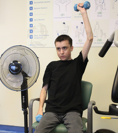 Image of Reid lifting weights