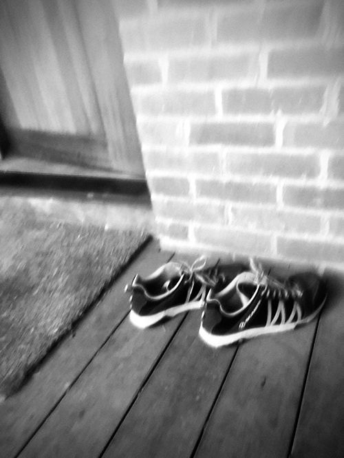 Shoes outside door of house