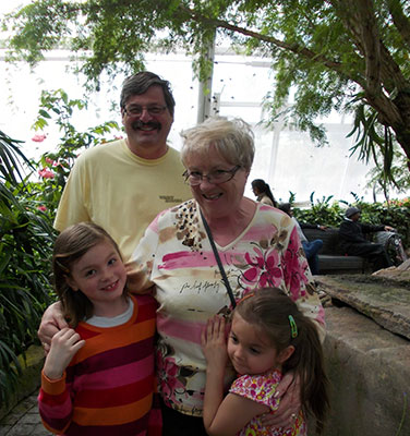 Image of Gary and Anne Marie Pieterse with grandkids.